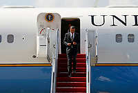 President Barack Obama exits his plane at the Charlottesville/Albemarle Airport in Charlottesville, VA.