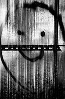 Switzerland. Canton Ticino. Lugano. A handpainted smiley on a construction wall made of plexiglass. A smiley (sometimes called a happy face or smiley face) is a stylized representation of a smiling humanoid face that is a part of popular culture worldwide. 14.04.2020 © 2020 Didier Ruef
