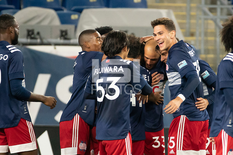 FOXBOROUGH, MA - OCTOBER 09: Tiago Mendonca #33 of New England Revolution II is congratulated for his goal during a game between Fort Lauderdale CF and New England Revolution II at Gillette Stadium on October 09, 2020 in Foxborough, Massachusetts.
