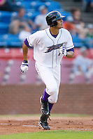 Salvador Sanchez #7 of the Winston-Salem Dash watches the flight of the baseball as he runs down the first base line at Wake Forest Baseball Stadium August 8, 2009 in Winston-Salem, North Carolina. (Photo by Brian Westerholt / Four Seam Images)