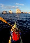 """Mexico, sea kayaker, Bahia Tenacatita, La Manzanilla, paddling toward """"The Churches"""" rock formation, Puerto Vallarta area, Jalisco, West coast of Mexico, Released"""