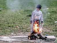 Pictured: A barefoot boy plays about at the camp Monday 07 March 2016<br /> Re: Refugees at the Greek FYRO Macedonian border in Idomeni, Greece.