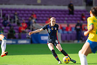 ORLANDO CITY, FL - FEBRUARY 21: Rose Lavelle #16 of the USWNT kicks the ball during a game between Brazil and USWNT at Exploria Stadium on February 21, 2021 in Orlando City, Florida.