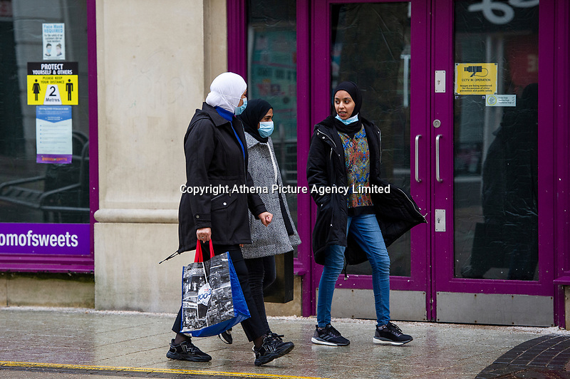 Pictured: Three masked ladies walk past Queen's Arcade in Cardiff, Wales, UK. Friday 8th January 2021<br /> Re: The whole of Wales in in Tier 4 due to rising Covid-19 Coronavirus cases, Cardiff, Wales, UK.
