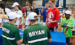 Bob and Mike Bryan sign autographs for kids following the Freedoms vs. Explorers WTT match in Villanova, PA on July 16, 2012