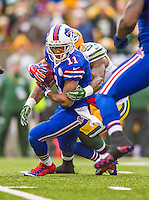 14 December 2014: Buffalo Bills running back Marcus Thigpen returns a 38-yard punt in the first quarter against the Green Bay Packers at Ralph Wilson Stadium in Orchard Park, NY. The Bills defeated the Packers 21-13, snapping the Packers' 5-game winning streak and keeping the Bills' 2014 playoff hopes alive. Mandatory Credit: Ed Wolfstein Photo *** RAW (NEF) Image File Available ***