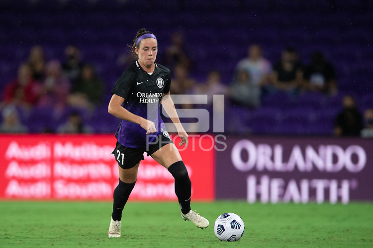 ORLANDO, FL - SEPTEMBER 11: Phoebe McClernon #21 of the Orlando Pride dribbles the ball during a game between Racing Louisville FC and Orlando Pride at Exploria Stadium on September 11, 2021 in Orlando, Florida.