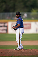 Missoula Osprey starting pitcher Mailon Arroyo (47) gets ready to deliver a pitch during a Pioneer League game against the Orem Owlz at Ogren Park Allegiance Field on August 19, 2018 in Missoula, Montana. The Missoula Osprey defeated the Orem Owlz by a score of 8-0. (Zachary Lucy/Four Seam Images)