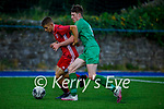 Kerry's Alex Hennigan and Eanna Fitzgerald of Cork City tussle for possession in the U17 Mark Farran Cup