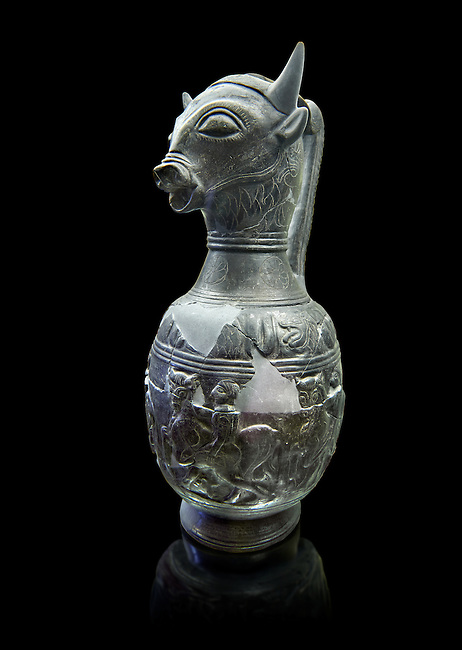 Three quarters view of the 6th century BC Etruscan Bull headed bucherro style oinochoe, or wine jug,  made in Chuisi and excavated from the necropolis de Fonte Rotella, inv 3190, National Archaeological Museum Florence, Italy , black background