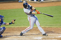 Fresno Grizzlies first baseman Adam Duvall (29) swings the bat during the Pacific Coast League baseball game against the Round Rock Express on June 22, 2014 at the Dell Diamond in Round Rock, Texas. The Express defeated the Grizzlies 2-1. (Andrew Woolley/Four Seam Images)