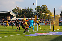 9th October 2021;  VBS Community Stadium, Sutton, London; EFL League 2 football, Sutton United versus Port Vale; David Ajiboye (7) of Sutton United heading the ball back across goal over goalkeeper Lucas Covolan  of Port Vale.