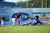 Batavia Muckdogs shortstop Samuel Castro (25) tags Jim Haley (38) sliding into second during a game against the Hudson Valley Renegades on August 2, 2016 at Dwyer Stadium in Batavia, New York.  Batavia defeated Hudson Valley 2-1. (Mike Janes/Four Seam Images)