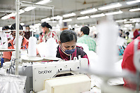 The cut fabric is  sent for stitching which is carried out mostly by women. More than 80% of the country's nearly 3.5 million garment factory workers are women. Gazipur, near Dhaka, Bangladesh