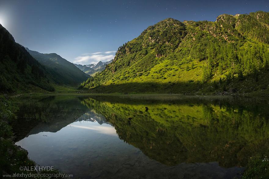 Alpine landscape at night, illuminated by moonlight. Nordtirol, Austrian Alps. July.