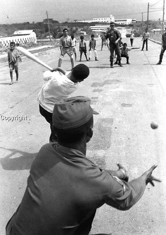 G.I.'s playing baseball with Dominican kids.  Santo Domingo, May 5, 1965.  Jack Lartz.  (USIA)<br /> NARA FILE #:  306-PSC-65-2011<br /> WAR & CONFLICT BOOK #:  380
