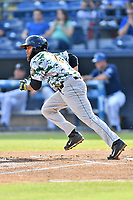 Augusta GreenJackets center fielder Cristian Paulino (9) runs to first base during a game against the Asheville Tourists at McCormick Field on July 15, 2017 in Asheville, North Carolina. The Tourists defeated the GreenJackets 2-1. (Tony Farlow/Four Seam Images)