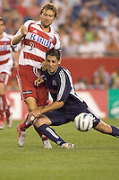 Clint Dempsey tries to maintain possession in front of Carey Talley. New England Revolution defeat FC Dallas, 3-2 at Gillette Stadium on July 16, 2005.