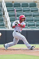 Wilmer Difo (6) of the Hagerstown Suns follows through on his swing against the Kannapolis Intimidators at CMC-Northeast Stadium on June 1, 2014 in Kannapolis, North Carolina.  The Intimidators defeated the Suns 5-1 in game one of a double-header.  (Brian Westerholt/Four Seam Images)