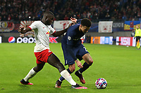 Dele Alli of Tottenham Hotspur and Dayot Upamecano of RB Leipzig during RB Leipzig vs Tottenham Hotspur, UEFA Champions League Football at the Red Bull Arena on 10th March 2020