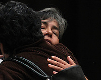 A woman whose daughter was  killed by drug cartels war in Xalapa, Veracruz, demostrate is comformted by another woman at Veracruzana University
