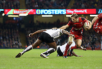 Pictured: Liam Williams of Wales (R) avoids a tackle by Vereniki Govena (L) of Fiji. Saturday 15 November 2014<br />