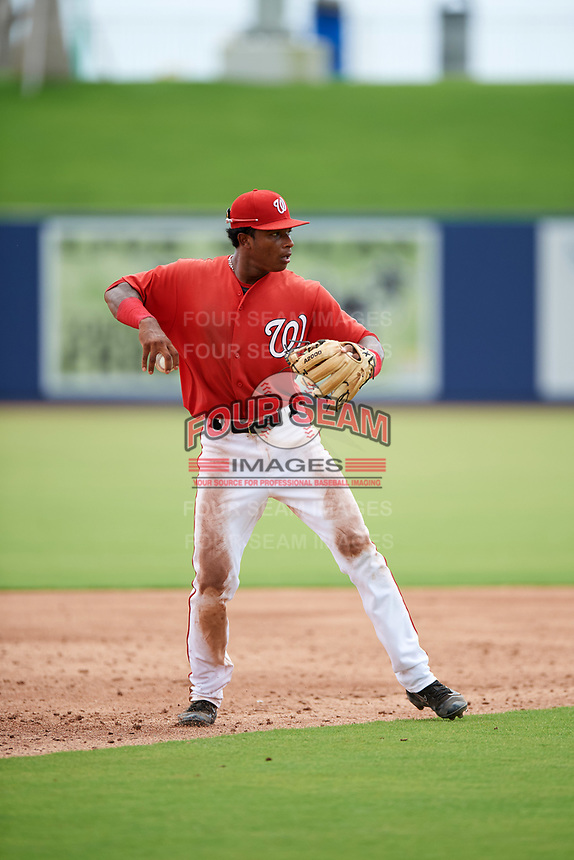 GCL Nationals shortstop Yasel Antuna (5) warmup throw to first base during the second game of a doubleheader against the GCL Mets on July 22, 2017 at The Ballpark of the Palm Beaches in Palm Beach, Florida.  GCL Mets defeated the GCL Nationals 4-1.  (Mike Janes/Four Seam Images)