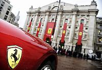A Ferrari car in front of the stock exchange palace <br /> Milano 04-01-2016 Borsa <br /> Esordio in borsa per la Ferrari. <br /> The company Ferrari began trading at stock exchange today <br /> foto Daniele Buffa/Image Sport/Insidefoto