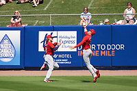 St. Louis Cardinals outfielder Dylan Carlson (3) attempts to catch a fly ball while avoiding a collision with Harrison Bader (48) during a Major League Spring Training game against the New York Mets on March 19, 2021 at Clover Park in St. Lucie, Florida.  (Mike Janes/Four Seam Images)