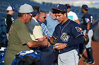San Antonio Missions Luis Urias (3) signs autographs for fans before a game against the Tulsa Drillers on June 1, 2017 at ONEOK Field in Tulsa, Oklahoma.  Tulsa defeated San Antonio 5-4 in eleven innings.  (Mike Janes/Four Seam Images)