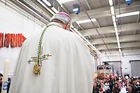 Switzerland. Canton Ticino. Bellinzona. Bishop Piergiacomo Grampa celebrates the mass on Easter sunday at Officine FFS. Catholic religious service. Stabilimento Industriale SBB CFF FFS Cargo. Railway workers on strike. Building's occupation. © 2008 Didier Ruef
