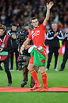 UEFA EURO 2016 Qualifier match between Wales and Andorra at Cardiff City Stadium in Cardiff : Gareth Bale celebrating at full time with a Welsh flag wrapped around his waist.
