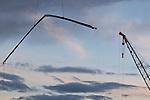 Crane swinging rebar during construction of Trimet's Portland-Milwaukie Light Rail Bridge.