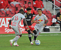 WASHINGTON, DC - SEPTEMBER 12: Kevin Paredes #30 of D.C. United battles for the ball with Dru Yearwood #16 and Kaku #10 of New York Red Bulls during a game between New York Red Bulls and D.C. United at Audi Field on September 12, 2020 in Washington, DC.