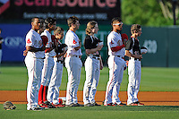 Infielders Rafael Devers (13), left, Mauricio Dubon (10), Nick Longhi (21) and Yoan Moncada (24) listen to the National Anthem before a game against the Lexington Legends on Tuesday, May 19, 2015, at Fluor Field at the West End in Greenville, South Carolina. The Cuban-born 19-year-old Red Sox signee has been ranked the No. 1 international prospect in baseball by Baseball America. (Tom Priddy/Four Seam Images)