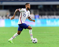 DALLAS, TX - JULY 25: Kellyn Acosta #23 of the United States brings the ball up the field during a game between Jamaica and USMNT at AT&T Stadium on July 25, 2021 in Dallas, Texas.