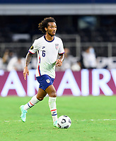 DALLAS, TX - JULY 25: Gianluca Busio #6 of the United States brings the ball up the field during a game between Jamaica and USMNT at AT&T Stadium on July 25, 2021 in Dallas, Texas.