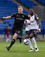 Bolton Wanderers' Ricardo Santos breaks under pressure from Oldham Athletic's Danny Rowe (left) <br /> <br /> Photographer Andrew Kearns/CameraSport<br /> <br /> The EFL Sky Bet League Two - Bolton Wanderers v Oldham Athletic - Saturday 17th October 2020 - University of Bolton Stadium - Bolton<br /> <br /> World Copyright © 2020 CameraSport. All rights reserved. 43 Linden Ave. Countesthorpe. Leicester. England. LE8 5PG - Tel: +44 (0) 116 277 4147 - admin@camerasport.com - www.camerasport.com