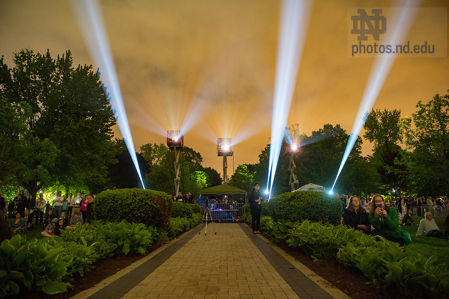 """May 19, 2018; 2018 """"Under the Dome: Celebrating 175 Years of Notre Dame,"""" a 3D mapping projection video that uses the architecture of the Main Building and Basilica of the Sacred Heart as a canvas to bring to life great moments in the University's history. (Photo by Barbara Johnston/University of Notre Dame)"""