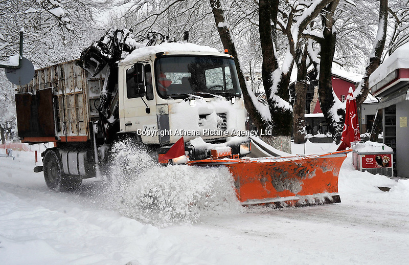 Pictured: A snow plough clears the roads in Ioannina, Greece. Wednesday 11 January 2017<br /> Re: Heavy snow has affected the town of Ioannina, northern Greece