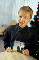 "Montreal (Qc) CANADA - File Photo - circa 1999<br /> <br /> Michael Junior hold his cd Dreamland.<br /> <br /> Michael Junior (Verschuere) was born on April 21, 1986 in Bruges St. Lucas, Belgium and grew up in Geidelberg straat. He made his singing debut in March of 1998 with Helmut Lotti at the Casino of Oostende in Belgium. Michael is becoming world famous after producing three incredible albums ""Dreamland"", ""Musica e la vita"", ""You Raise Me Up"" and his most recent album, ""Life in English""."