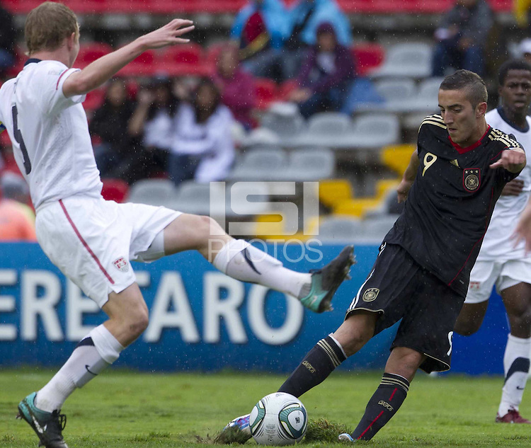 .Action photo of Samed Yesil (R) of Germany and Matthew Dunn (L) of USA, during game of the FIFA Under 17 World Cup game, held at Queretaro.