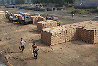 A clay brick factory in Bazhou, Hebei province, China. The brickkiln was built during Mao's the Great Leap Forward campaign in 1958. With a rapid ecomomic growth in China, more than 120,000 bricks are made from the brickkiln per day nowdays, though clay bricks has been prohibited from using in more than 170 cities of China since 2002 to protect the fertile land..04-SEP-04