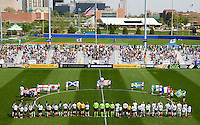 St Louis Athletica and the Los Angeles Sol stand on the field as the national anthem is sung before a WPS match at Hermann Stadium, in St. Louis, MO, April 25 2009.  Athletica and Sol tied the match.