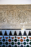 Arabesque Mudjar plaster work and Zillige tiles inside the Vestibule of Don Pedro's Palace, completed in 1366. Alcazar of Seville, Seville, Spain