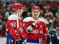 WASHINGTON, DC - JANUARY 31: Dmitry Orlov #9 with Evgeny Kuznetsov #92 of the Washington Capitals during a game between New York Islanders and Washington Capitals at Capital One Arena on January 31, 2020 in Washington, DC.