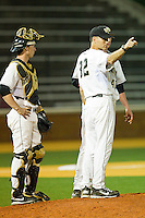 Wake Forest Demon Deacons head coach Tom Walter #32 makes the call for a relief pitcher during the game against the Charlotte 49ers at Gene Hooks Field on March 22, 2011 in Winston-Salem, North Carolina.   Photo by Brian Westerholt / Four Seam Images