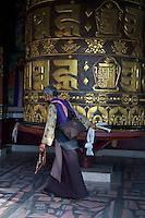 Huge Prayer Wheel at the Kopan Monastery of Tibetan origin in Kathmandu Nepal