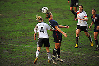 Abby Wambach beats Germany's Babett Peter to the ball.  The USA captured the 2010 Algarve Cup title by defeating Germany 3-2, at Estadio Algarve on March 3, 2010.