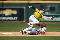 Mark Vierling (9) of the Missouri Tigers reaches for a wide throw as Trent Brown (2) of the Oklahoma Sooners slides into second base in game four of the 2020 Shriners Hospitals for Children College Classic at Minute Maid Park on February 29, 2020 in Houston, Texas. The Tigers defeated the Sooners 8-7. (Brian Westerholt/Four Seam Images)